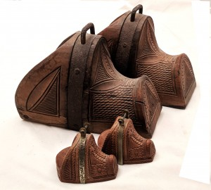 Miniature wooden stirrups from Chile
